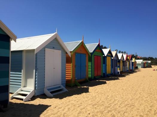 Brightly coloured huts on Brighton beach